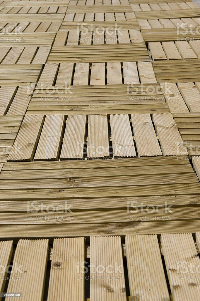 Wood panelled flooring beside swimming pool in Ischia stock photo