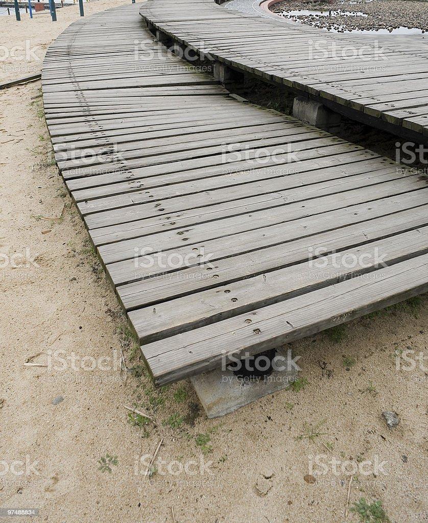 Wood pavement on sand royalty-free stock photo