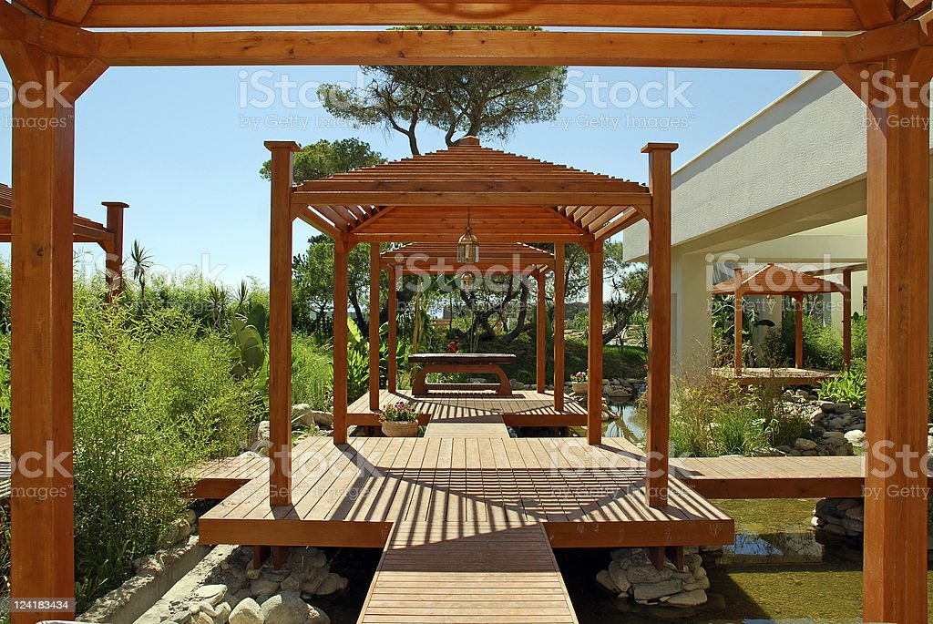 wood pavilion, deck and tropical plants in summer resort stock photo