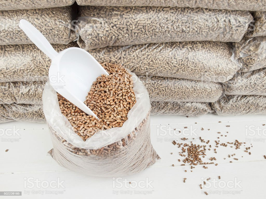 wood pellets and scoop stock photo