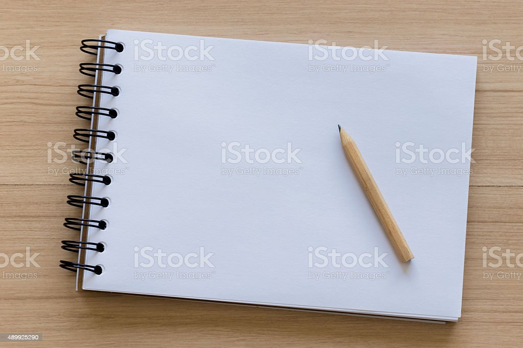 Wood Pencil Placed on a Blank Notebook stock photo