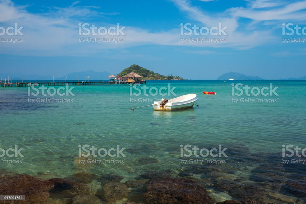 Wood pier and wooded bridge in Koh Mak and boat stock photo
