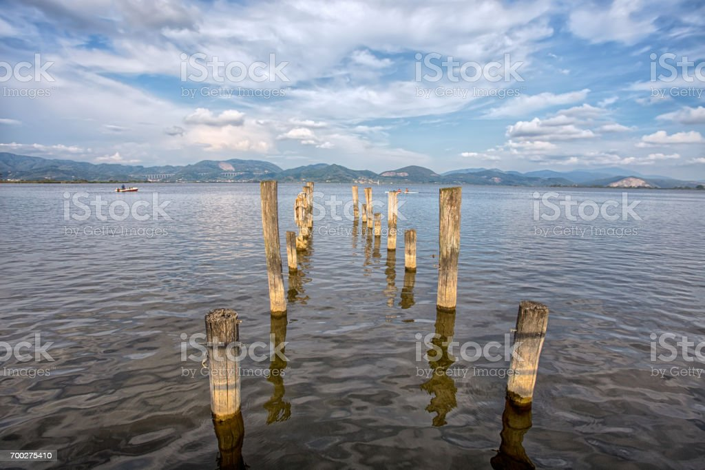 Wood pier in Torre del Lago Puccini, Pisa, Tuscany, Italy stock photo