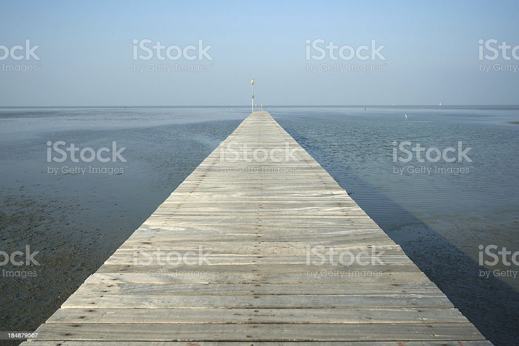 Wood Pier to the Sea stock photo