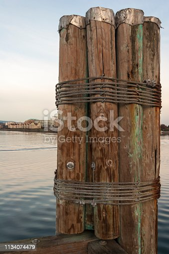 Wood Pilings and Boat at Port.