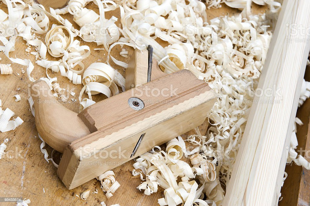 Wood plane on a woodworking bench, with shavings royalty-free stock photo