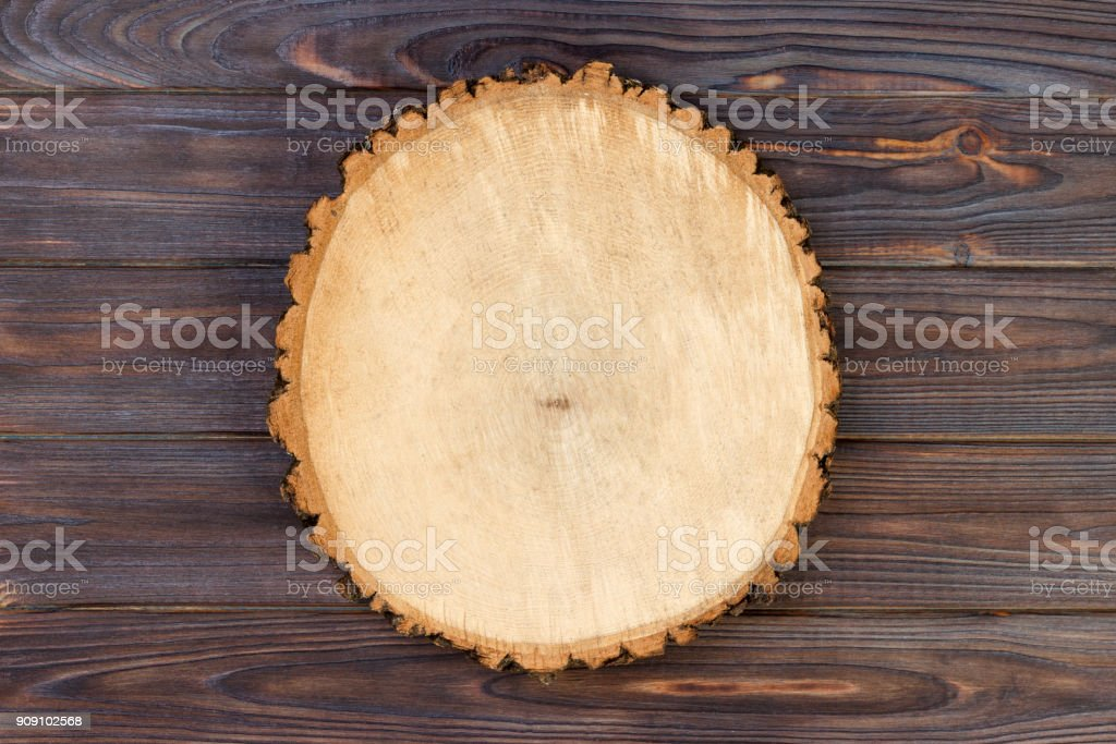 Wood plank board on wooden table. Top view with copy space stock photo