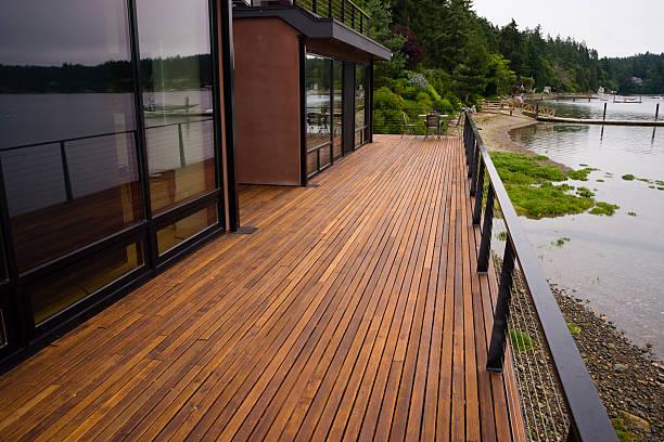 wood plank deck patio beach water contemporary waterfront home - i̇nsan yapımı yapı stok fotoğraflar ve resimler