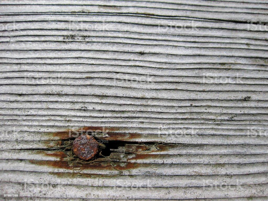 Wood plank w/ a rusty nail royalty-free stock photo