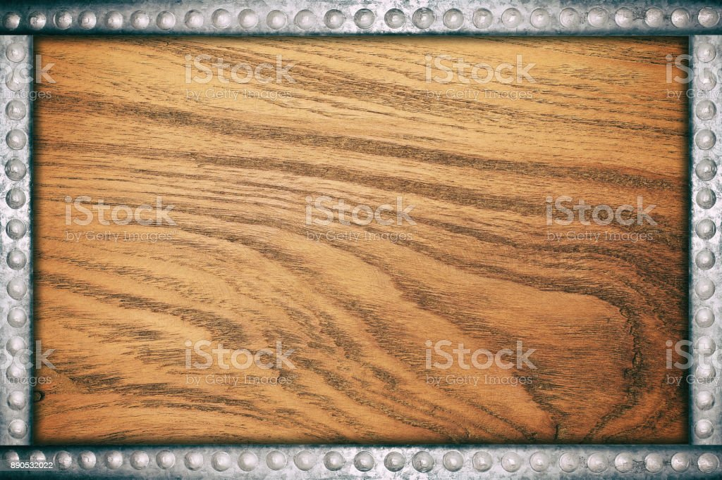 Wood plate background with metal rivets frame stock photo