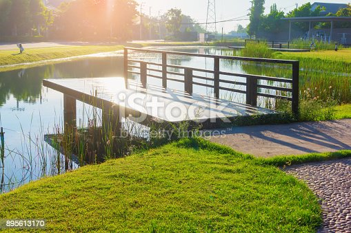 istock wood porch front of lake at garden 895613170