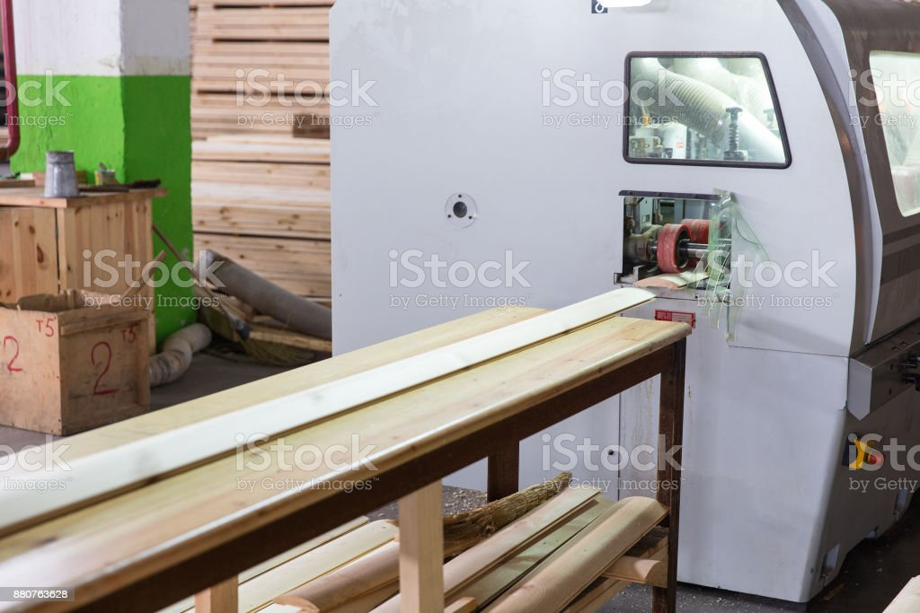 Wood processing line at the woodworking plant stock photo