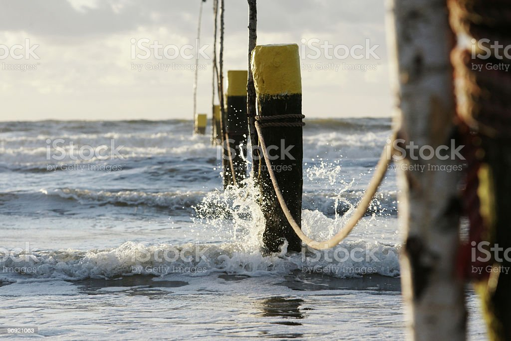 Wood pylons at the beach Norderney royalty-free stock photo
