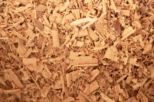 Wood sawdust background closeup. Sawdust texture, close-up background of brown sawdust.