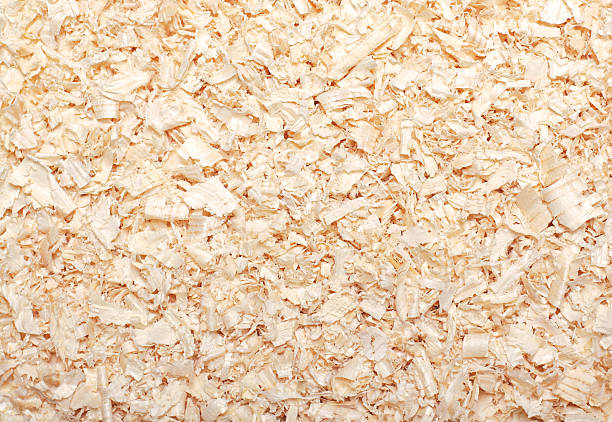 Wood sawdust texture material background closeup, top view stock photo