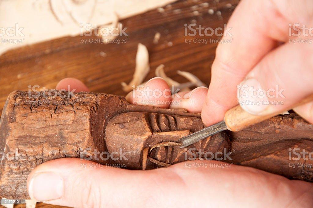 Wood sculpting stock photo