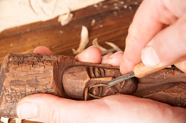 Wood sculpting Wood sculpting in linden wood carving craft product stock pictures, royalty-free photos & images