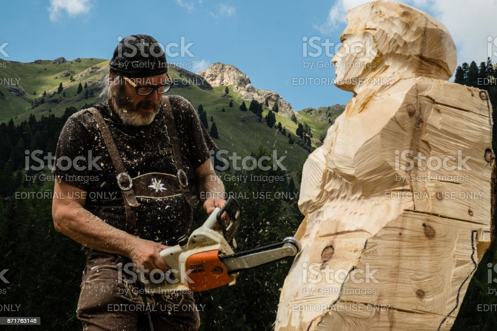 Wood sculptor at work at Festa Ta Mont, traditional Ladino festival stock photo