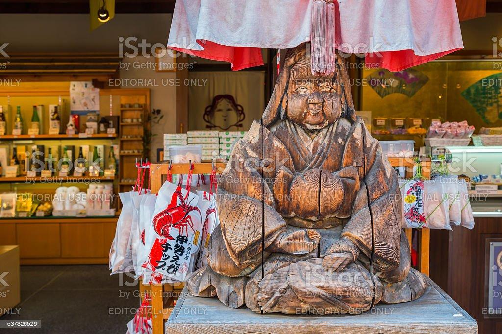 Wood sculpture of Japanese priestess stock photo