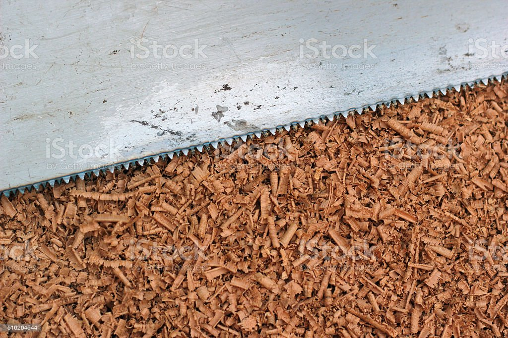 Wood shavings and saw blade texture background stock photo