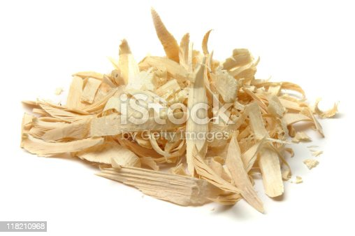 An isolated pile of wood shavings from wood working, whittling, etc. Isolated on white.