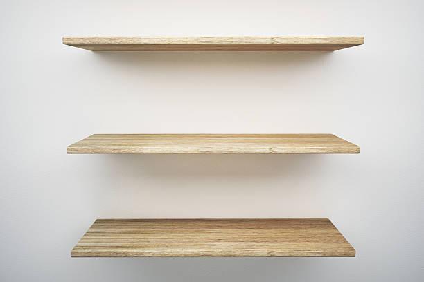 wood shelf on white wall stock photo