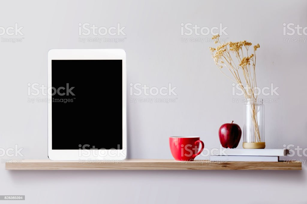Cтоковое фото Wood shelf with tablet and coffee.