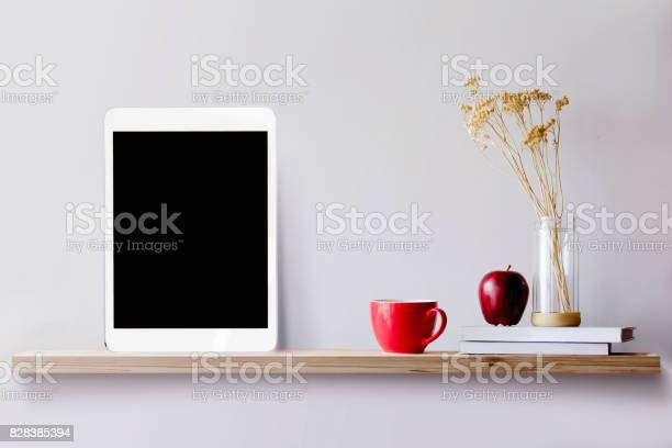 Photo of Wood shelf with tablet and coffee.
