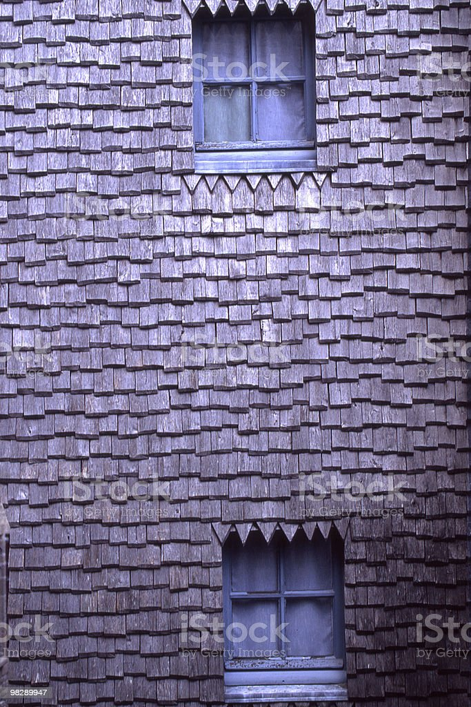 Wood Shingle Wall with windows at Saint Michaels Mount, France royalty-free stock photo
