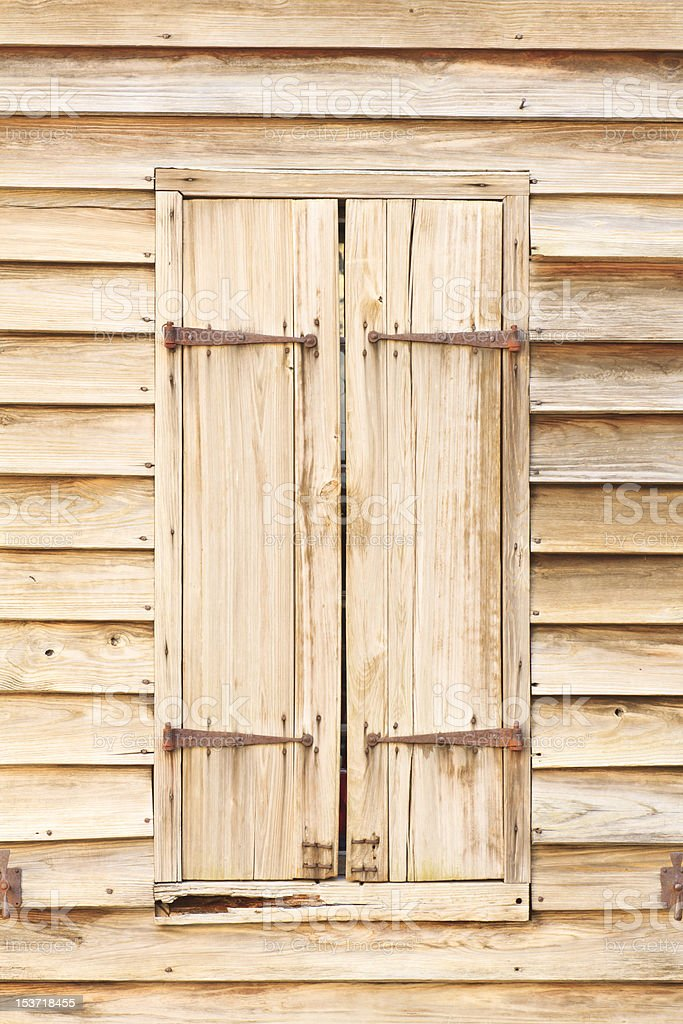 Wood Shutters On Historic Building royalty-free stock photo