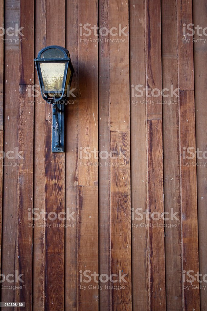 Wood siding with a lamp/light stock photo
