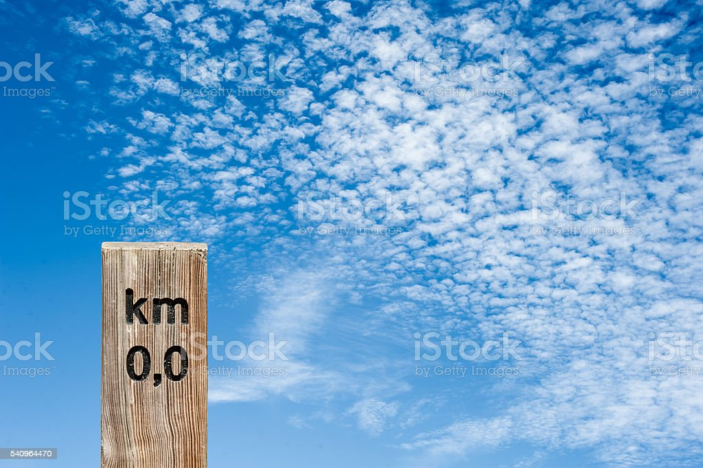 Wood sign with clouds background stock photo