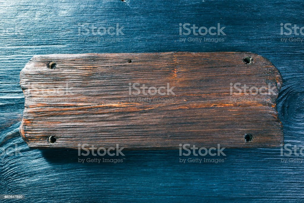 Wood signboard on black wood surface stock photo