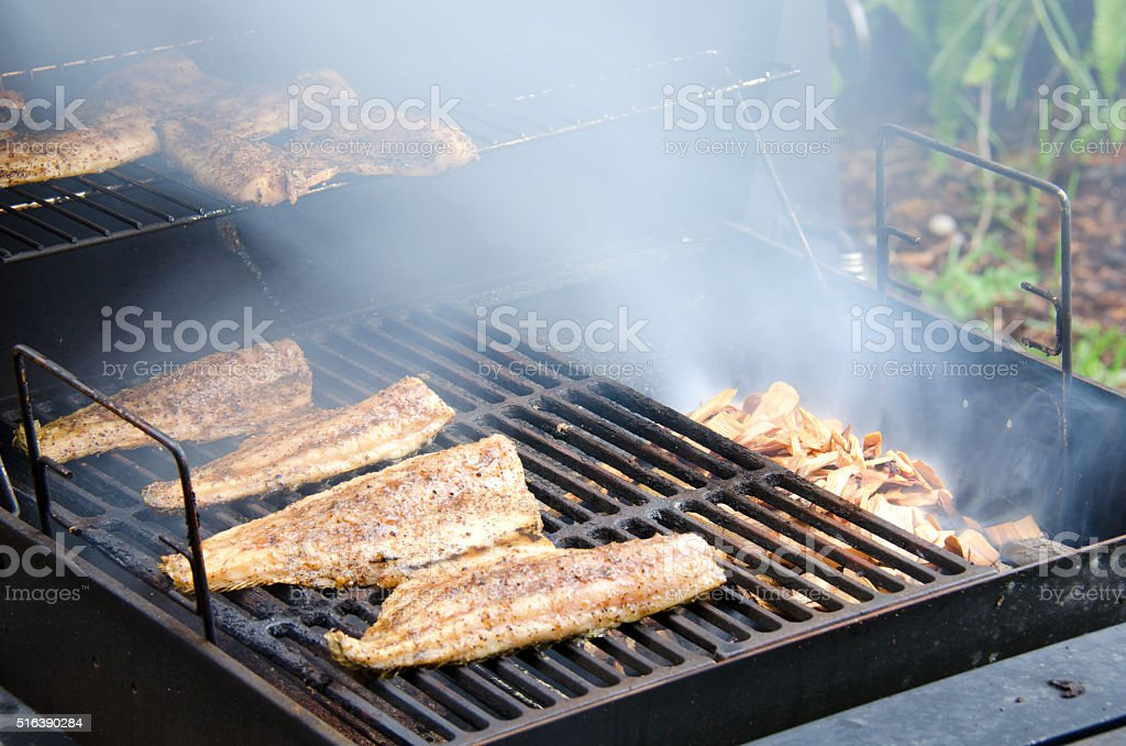 Wood smoked smoking mullet fish stock photo