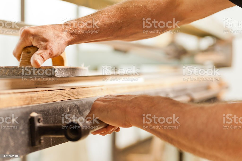 wood smoothing with belt sander stock photo