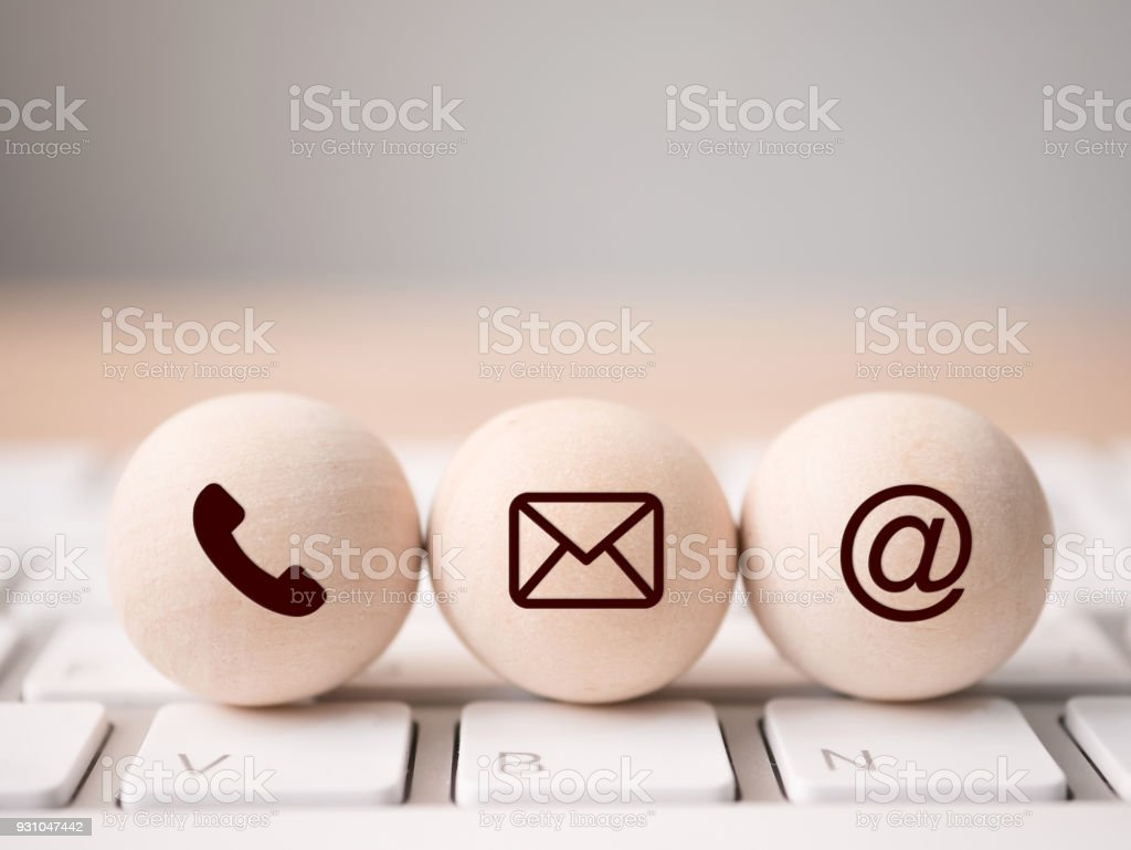 Wood sphere symbol telephone, mail, address and mobile phone. Website page contact us or e-mail marketing concept stock photo