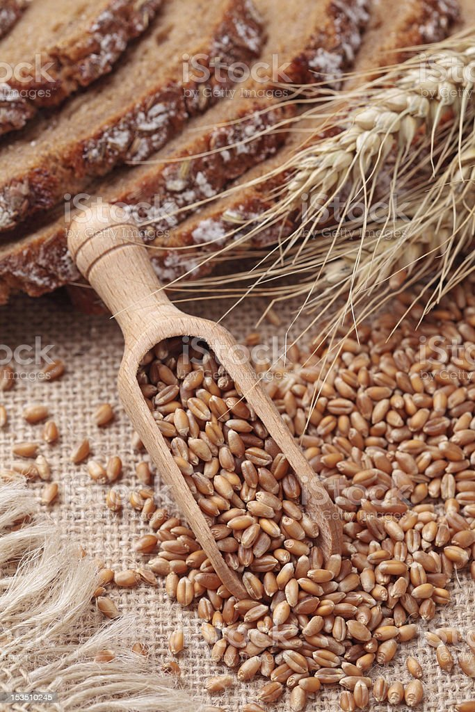 Wood spoon with wheat grains royalty-free stock photo