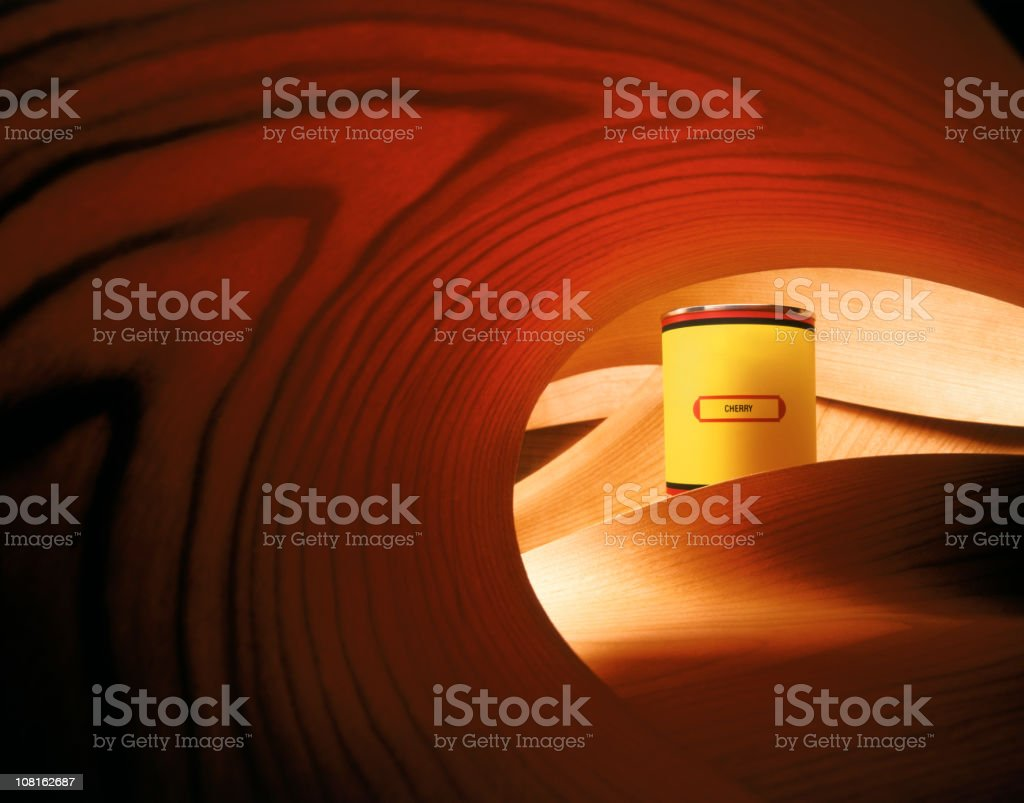 Wood Stain Paint Can Surrounded by Cherrywood royalty-free stock photo