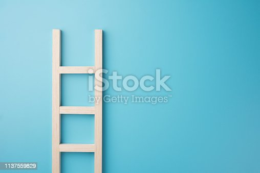 istock Wood staircase isolated on blue wall texture background  business growth concept photo object design 1137559829