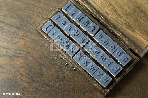 istock wood stamp alphabet close up image for background. 1058710344
