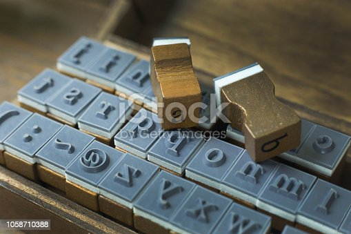 istock wood stamp alphabet close up image for background. 1058710388