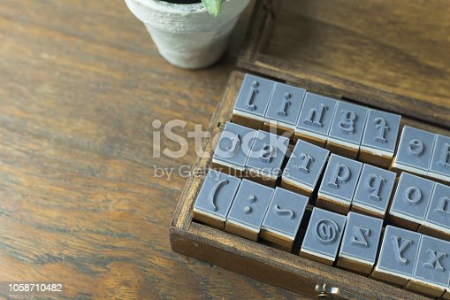 istock wood stamp alphabet close up image for background. 1058710482