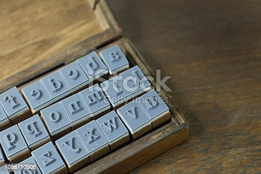 istock wood stamp alphabet close up image for background. 1058710508