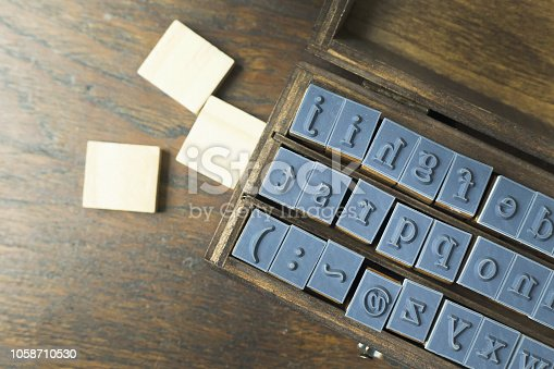 istock wood stamp alphabet close up image for background. 1058710530