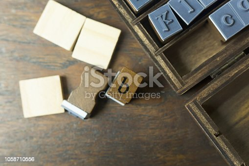 istock wood stamp alphabet close up image for background. 1058710556