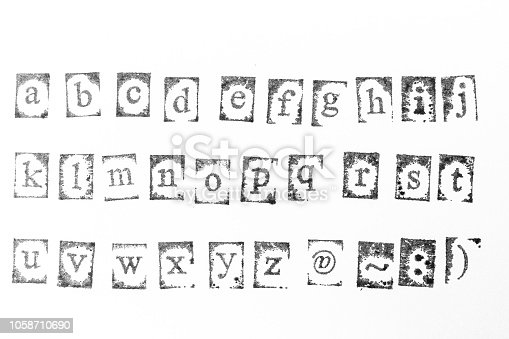 istock wood stamp alphabet close up image for background. 1058710690