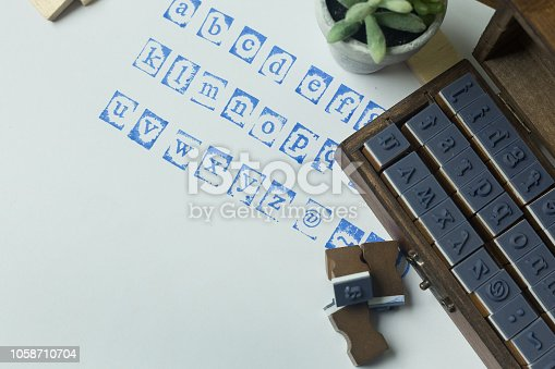 istock wood stamp alphabet close up image for background. 1058710704