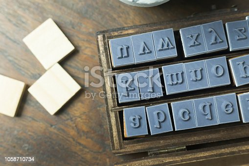 istock wood stamp alphabet close up image for background. 1058710734