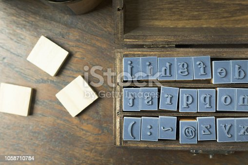 istock wood stamp alphabet close up image for background. 1058710784