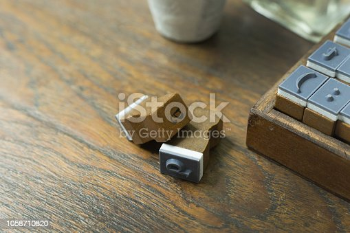 istock wood stamp alphabet close up image for background. 1058710820
